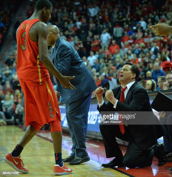 Head coach Sean Miller of the Arizona Wildcats yells at Dylan Smith of the Arizona Wildcats during a timeout during their game against the UNLV...