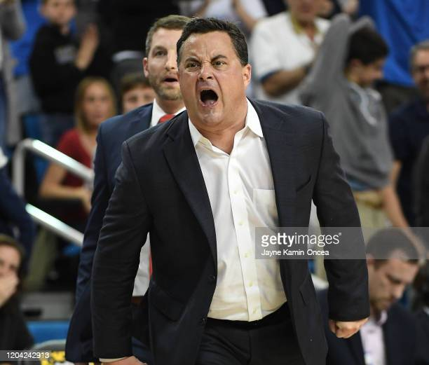 Head coach Sean Miller of the Arizona Wildcats yells at officials as he is given a technical foul after showing his displeasure after he thought Nico...