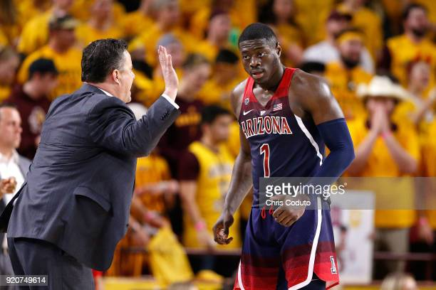 Head coach Sean Miller talks with Rawle Alkins of the Arizona Wildcats during the second half of the college basketball game against the Arizona...