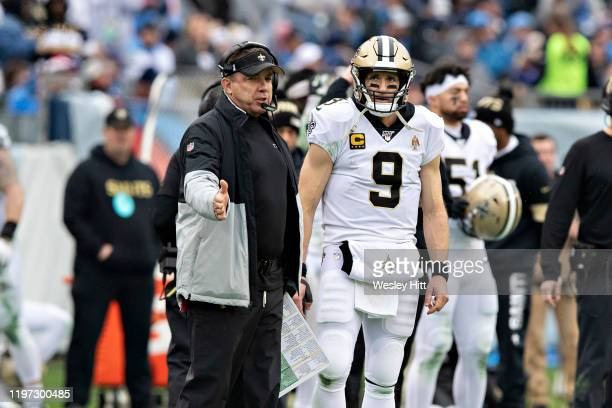 Head Coach Sean Payton and Drew Brees of the New Orleans Saints on the sidelines during a game against the Tennessee Titans at Nissan Stadium on...