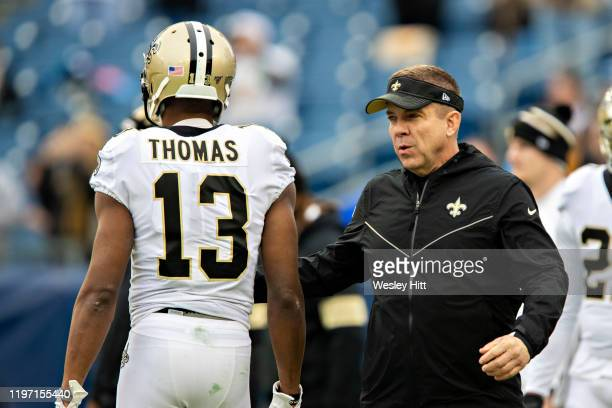 Head Coach Sean Payton and Michael Thomas of the New Orleans Saints on the field before a game against the Tennessee Titans at Nissan Stadium on...