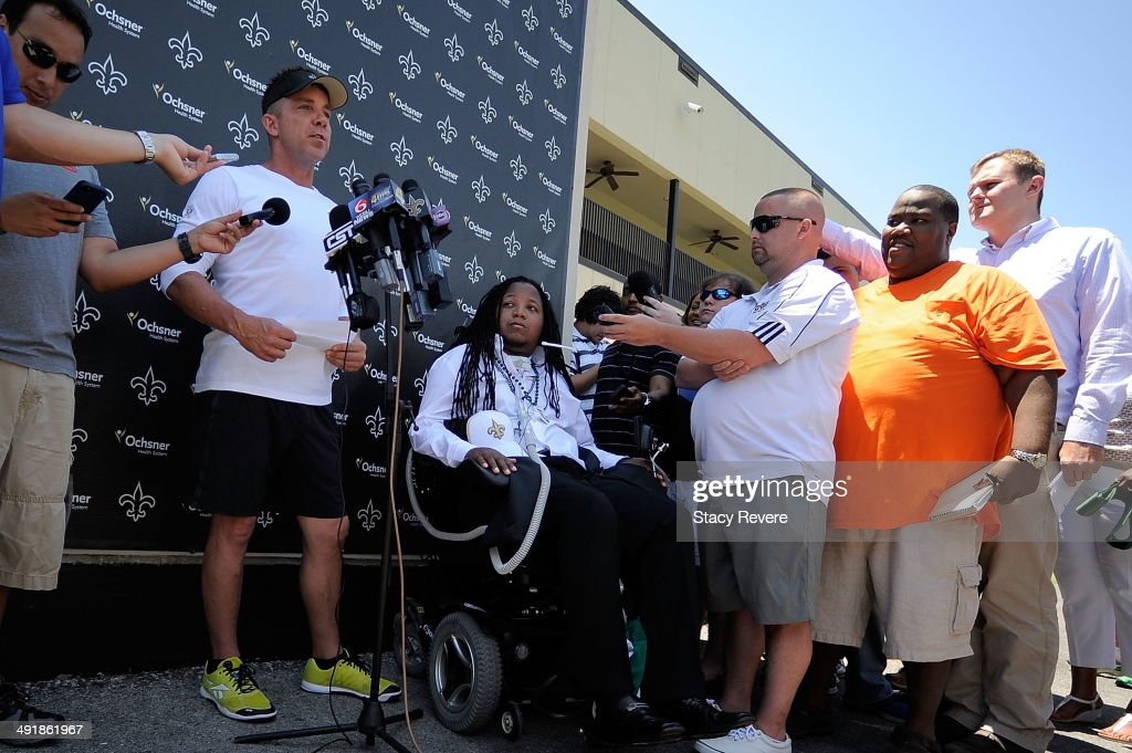 Head coach Sean Payton (L) announces that former Tulane football player Devon Walker has been signed to a free agent contract following the New Orleans Saints rookie minicamp at the Saints training facility on May 17, 2014 in Metairie, Louisiana. Devon Walker was paralyzed from the neck down in 2012 during a game against Tulsa.