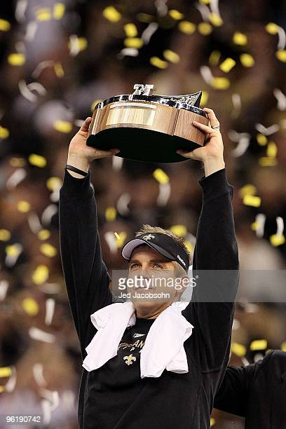 Head coach Sean Payton of the New Orleans Saints celebrates with the George S. Halas Trophy after the Saints won 31-28 in overtime against the...