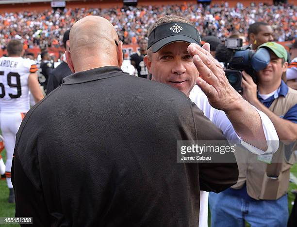 Head coach Sean Payton of the New Orleans Saints congratulates Mike Pettine of the Cleveland Browns after Clevelands 2624 win at FirstEnergy Stadium...