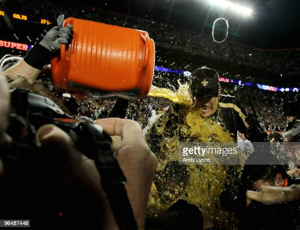 Head coach Sean Payton of the New Orleans Saints gets Gatorade dumped on him after defeating the Indianapolis Colts during Super Bowl XLIV on...
