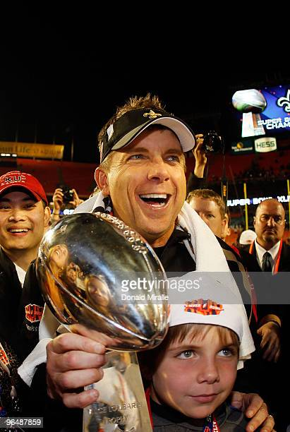 Head coach Sean Payton of the New Orleans Saints holds the Vince Lombardi Trophy with his family after defeating the Indianapolis Colts during Super...