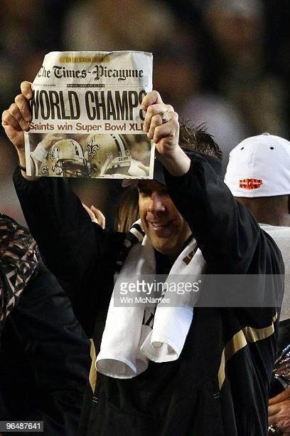 Head coach Sean Payton of the New Orleans Saints holds up a newspaper reading World Champs after defeating the Indianapolis Colts during Super Bowl...