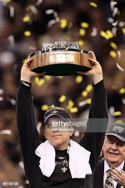 Head coach Sean Payton of the New Orleans Saints holds up the NFC Championship trophy after defeating the Minnesota Vikings to win the NFC...