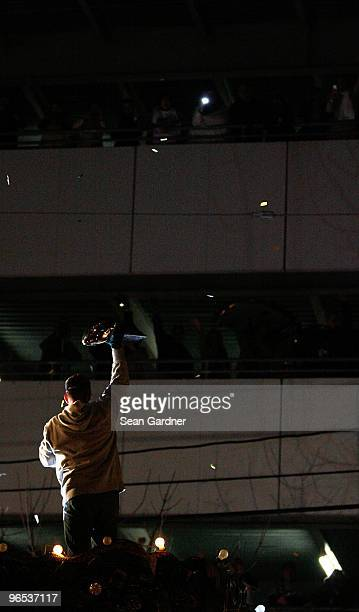 Head coach Sean Payton of the New Orleans Saints holds up the Lombardi Trophy as his team parades though the city after winning the Super Bowl XLIV...