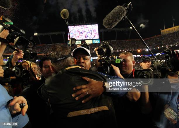 Head coach Sean Payton of the New Orleans Saints hugs Head coach Jim Caldwell of the Indianapolis Colts after the Saints defeated the Indianapolis...