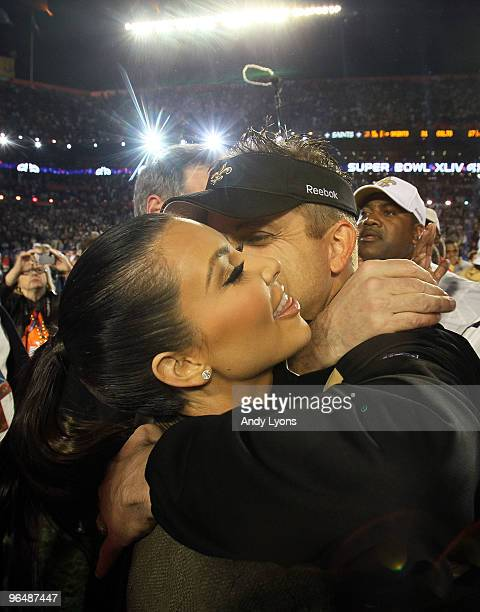 Head coach Sean Payton of the New Orleans Saints hugs TV personality Kim Kardashian after defeating the Indianapolis Colts during Super Bowl XLIV on...