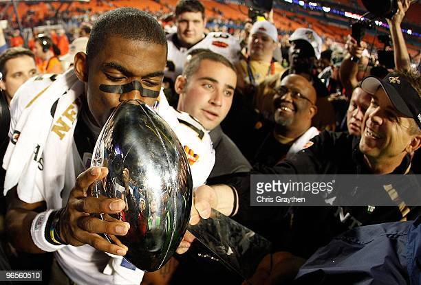 Head coach Sean Payton of the New Orleans Saints reaches out to have Marques Colston kiss the Vince Lombardi Trophy after defeating the Indianapolis...
