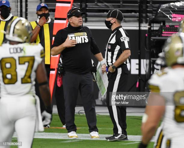 Head coach Sean Payton of the New Orleans Saints talks with side judge Laird Hayes during the first half of the NFL game against the Las Vegas...