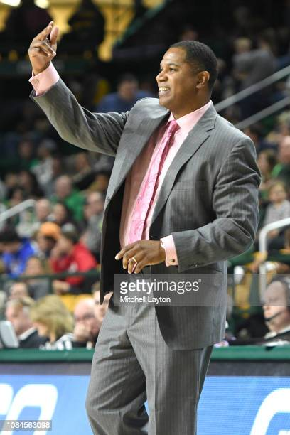 Head coach Sean Woods of the Southern University Jaguars signals to his players during a college basketball game against the George Mason Patriots at...