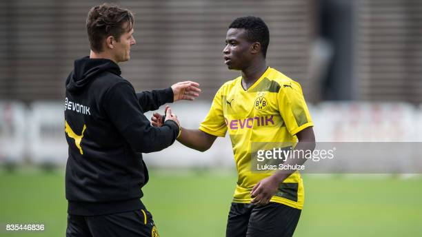 Head Coach Sebastian Geppert hugs Youssoufa Moukoko of Dortmund during the B Juniors Bundesliga match between Borussia Dortmund and FC Viktoria Koeln...