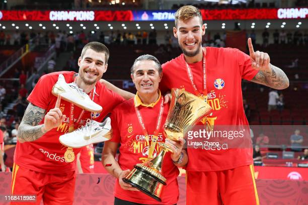 Head Coach Sergio Scariolo , Willy Hernangomez and Juan Hernangomez of Spain with the winning trophy celebrates after defeating Argentina during the...