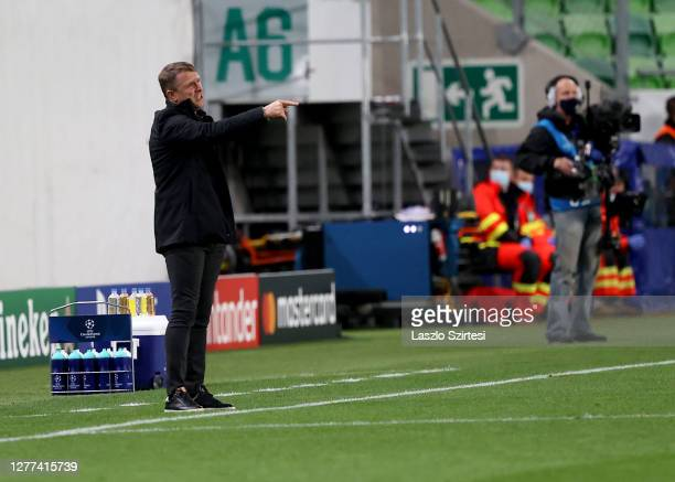 Head coach Serhiy Rebrov of Ferencvarosi TC reacts during the UEFA Champions League Play-Offs Second Leg match between Ferencvarosi TC and Molde FK...