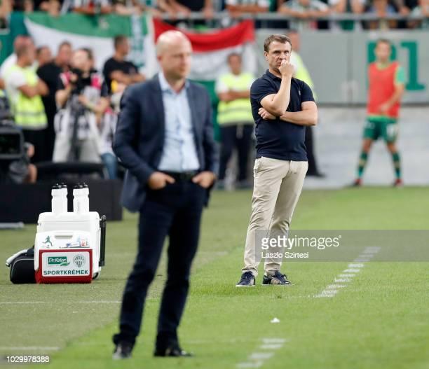 Head coach Serhiy Rebrov of Ferencvarosi TC watches the match behind head coach Marko Nikolic of MOL Vidi FC reacts during the Hungarian OTP Bank...