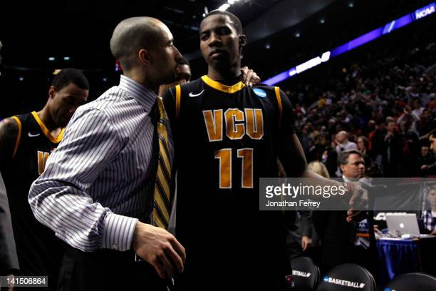 Head coach Shaka Smart and Rob Brandenberg of the Virginia Commonwealth Rams walk off the court after losing to the Indiana Hoosiers 63-61 during the...