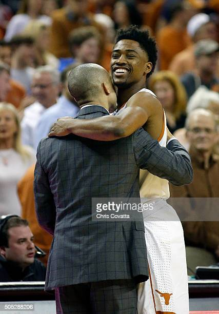 Head coach Shaka Smart of the Texas Longhorns hugs Isaiah Taylor before the game with the Oklahoma State Cowboys at the Frank Erwin Center on January...