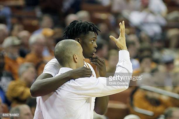 Head coach Shaka Smart of the Texas Longhorns talks with Andrew Jones during the game with the Oklahoma Sooners at the Frank Erwin Center on January...