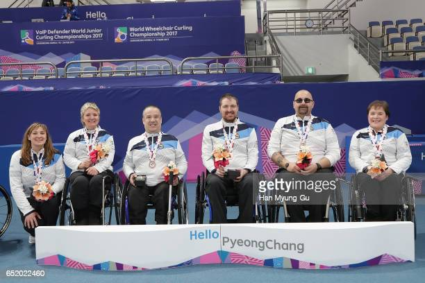 Head coach Sheila Swan bronze medalists Angie Malone Robert McPherson Hugh NibloeGregor Ewan and Aileen Neilson from Scotland celebrate in the medal...