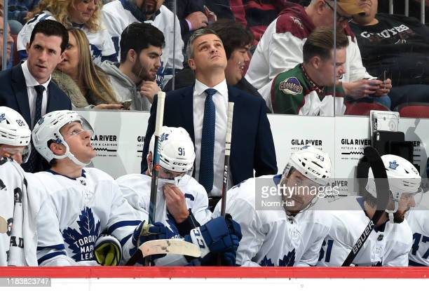 Head coach Sheldon Keefe of the Toronto Maple Leafs checks the scoreboard during first period action against the Arizona Coyotes at Gila River Arena...