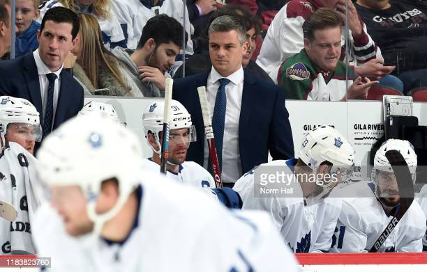 Head coach Sheldon Keefe of the Toronto Maple Leafs looks on from the bench during first period action against the Arizona Coyotes at Gila River...