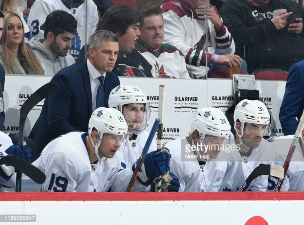 Head coach Sheldon Keefe of the Toronto Maple Leafs looks on from the bench during a game against the Arizona Coyotes at Gila River Arena on November...