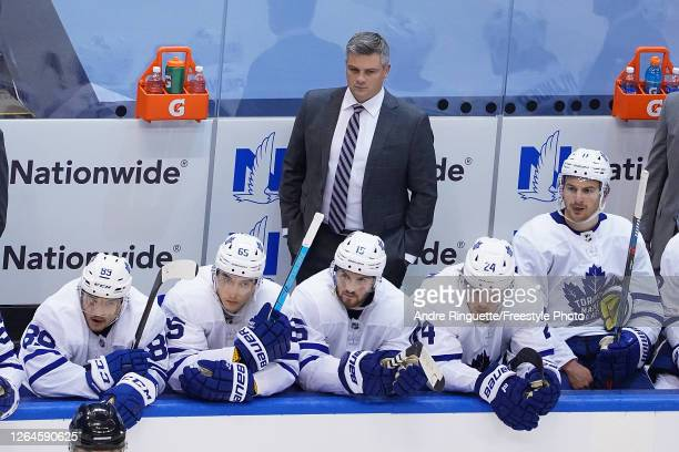 Head Coach Sheldon Keefe of the Toronto Maple Leafs looks on from the bench against the Columbus Blue Jackets in Game Four of the Eastern Conference...