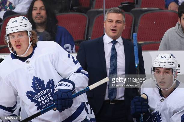 Head coach Sheldon Keefe of the Toronto Maple Leafs reacts on the bench alongside Kasperi Kapanen and Ilya Mikheyev during the second period of the...