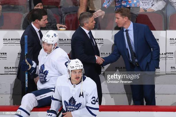 Head coach Sheldon Keefe of the Toronto Maple Leafs shakes hands with assistant coach Dave Hakstol after defeating the Arizona Coyotes in the NHL...
