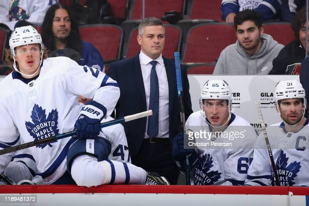 Head coach Sheldon Keefe of the Toronto Maple Leafs watches from the bench during the first period of the NHL game against the Arizona Coyotes at...