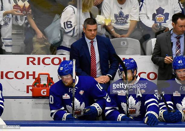 Head Coach Sheldon Keefe of the Toronto Marlies watches the play develop against the Texas Stars during game 6 of the AHL Calder Cup Final on June 12...