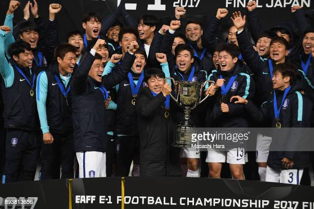 Head coach Shin TaeYong of South Korea lifts the trophy as they celebrate the East Asian Champions at the award ceremony following their 41 victory...