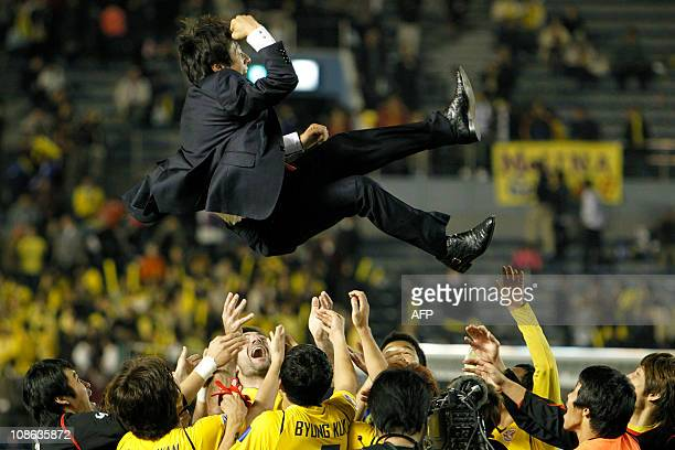 Head coach Shin TaeYong of South Korea's Seongnam Ilhwa is tossed by his players to celebrate their victory against Iran's Zobahan during the...
