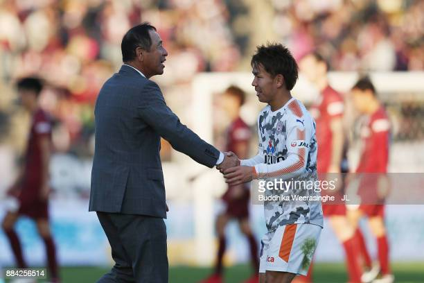 Head coach Shinji Kobayashi of Shimizu SPulse shakes hands with Shota Kaneko after their 31 victory and avoided the relegation to the J2 after the...