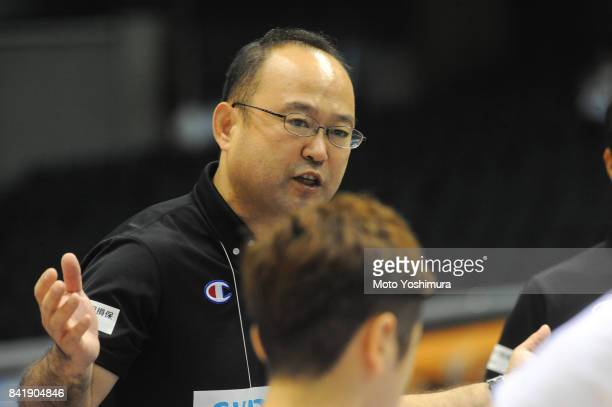 Head coach Shinpei Oikawa of Japan talks to his players uring the Wheelchair Basketball World Challenge Cup match between Japan and Turkey at the...