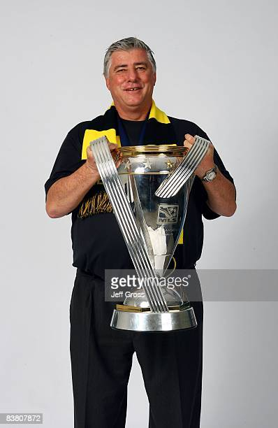 Head Coach Sigi Schmid of the Columbus Crew poses for a postgame celebration portrait with the Philip F Anschutz trophy after defeating the New York...