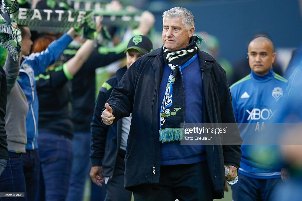 Head coach Sigi Schmid of the Seattle Sounders FC walks on to the pitch prior to the match against the New England Revolution at CenturyLink Field on March 8, 2015 in Seattle, Washington. The Sounders defeated the Revolution 3-0.