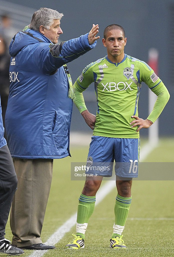 Head coach Sigi Schmid of the Seattle Sounders talks with David Estrada #16 during the match against the Los Angeles Galaxy at CenturyLink Field on May 2, 2012 in Seattle, Washington. The Sounders defeated the Galaxy 2-0.