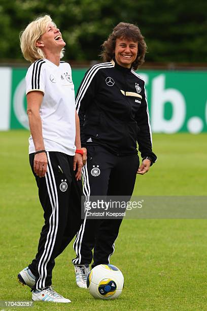 Head coach Silvia Neid and assistant coach Ulrike Ballweg laugh during the training session of Women's Team Germany at training ground Ueberruhr on...