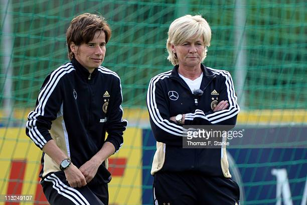 Head coach Silvia Neid and U15 head coach Bettina Wiegmann discuss during the German Women's National Team training session at the Sportsschool...