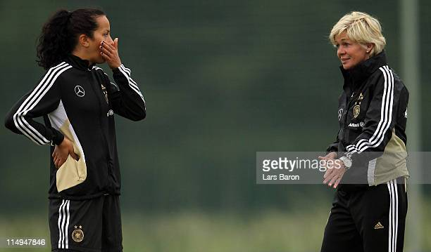 Head coach Silvia Neid gives instructions to Fatmire Bajramaj during a German Women National Team training session at Hotel Klosterpforte on May 31...