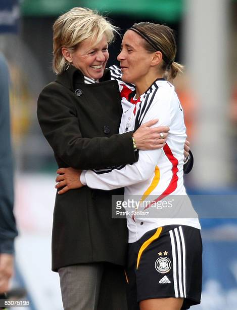 Head coach Silvia Neid holds Sandra Smisek of Germany after her last match for the national team during the 2009 UEFA European Championship...