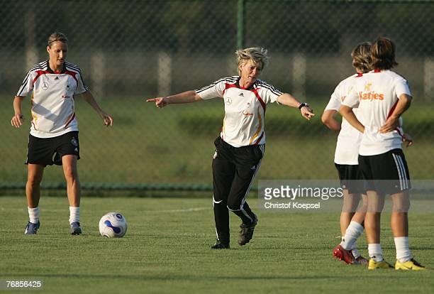 Head coach Silvia Neid issues instructions to her team during the Women's German National Team training session on the training ground at the Wuhan...