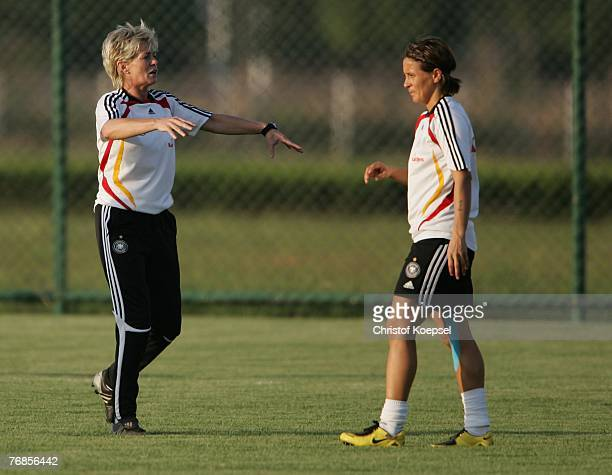 Head coach Silvia Neid issues instructions to Sandra Smisek during the Women's German National Team training session on the training ground at the...