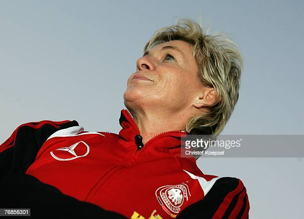 Head coach Silvia Neid looks on during the Women's German National Team training session on the training ground at the Wuhan Sports Center Stadium on...