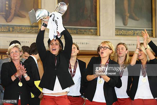 Head coach Silvia Neid Nadine Angerer Saskia Bartusiak and Lena Goessling of Germany during the celebration of the Women's team of Germany at...
