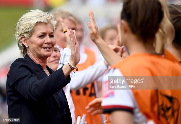 Head coach Silvia Neid of Germany celebrates after Anja Mittag scored her teams fifth goal during the FIFA Women's World Cup 2015 Group B match...